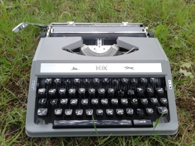 Typewriter on grass